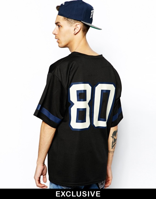 Reclaimed Vintage Longline Short Sleeve Mesh Shirt with number on the back. Available at this site for  $52.68